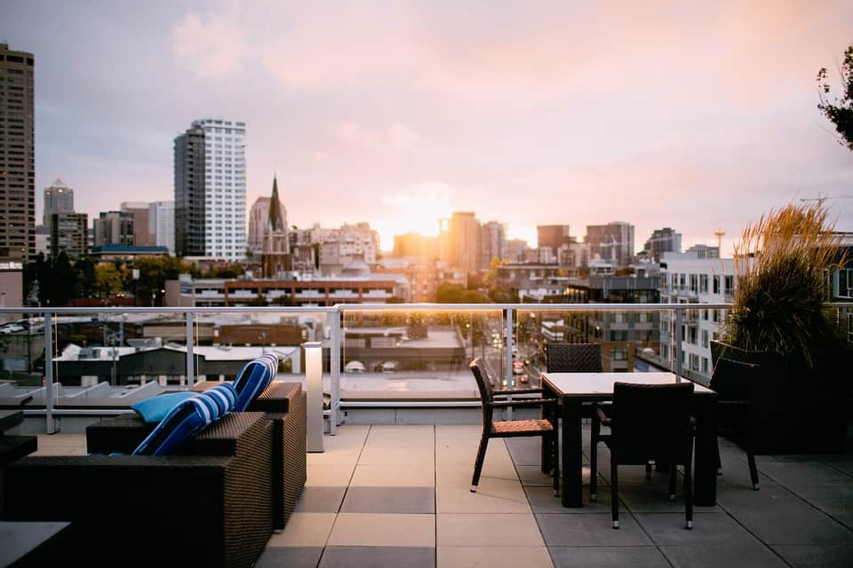 condo rooftop with wicker patio furniture